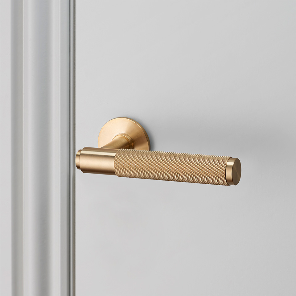 Buster Punch door lever handle brass UNSPRUNG high res sq 960x960px