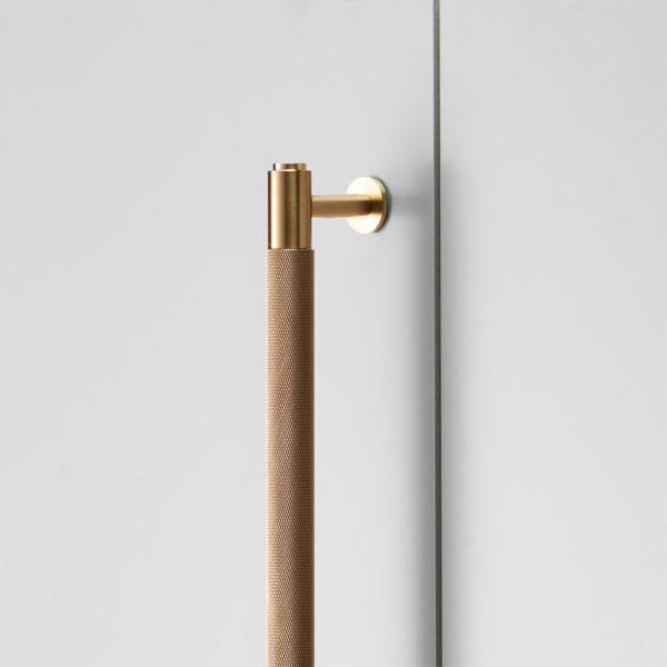 2. BusterPunch Closet Bar Brass Detail